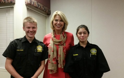 Nick Williams (Left) and Maria Rangel (Right) stand with mayor Jean Stothert at the OCCP Banquet. The two explorers helped set up and serve food to the citizen patrollers. Photo by Maddie McGrath