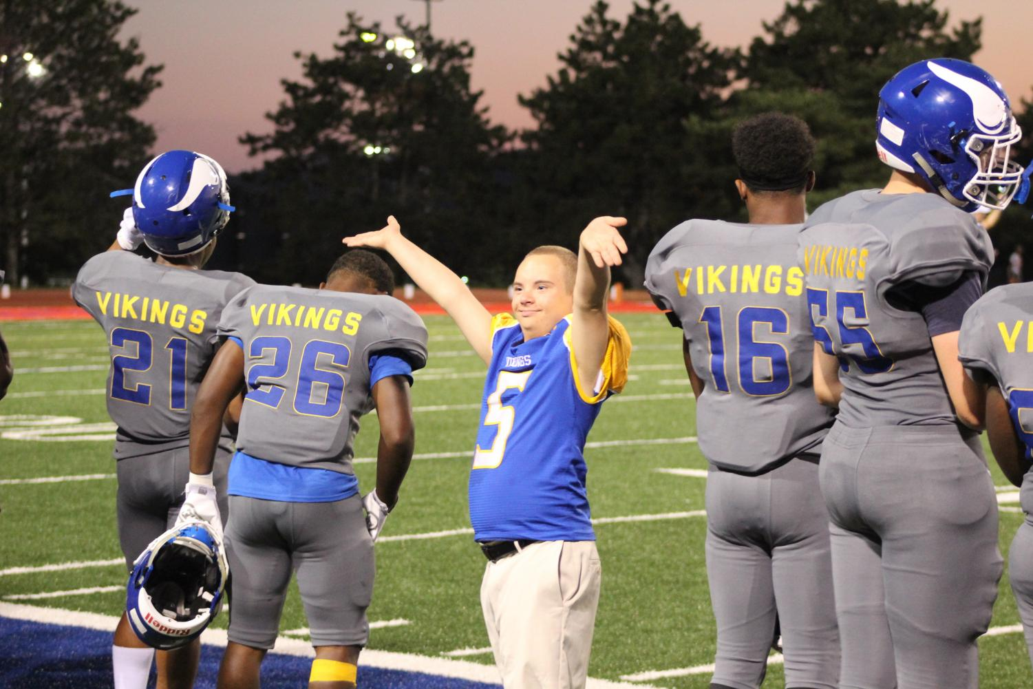 Jordan Burtzel waives his arms up and down to pump up the crowd at the football game against Burke at Northwest's Kinnick Stadium on September 14, 2018. Burtzel did this to get the crowd into the game, Burtzel often did this throughout the game.  Photo by Gabby Push