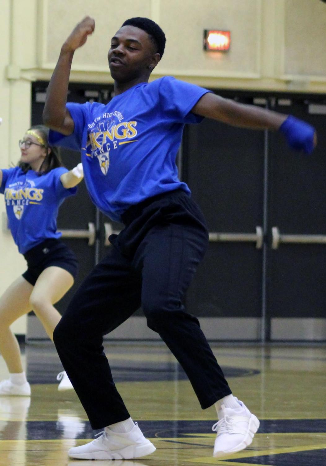 Danner, 10, dances next to other members of the Golden Vikings dance team. The dance team performed in all their glory at freshmen day during the opening pep-rally. Photo by Caitlin Pieters
