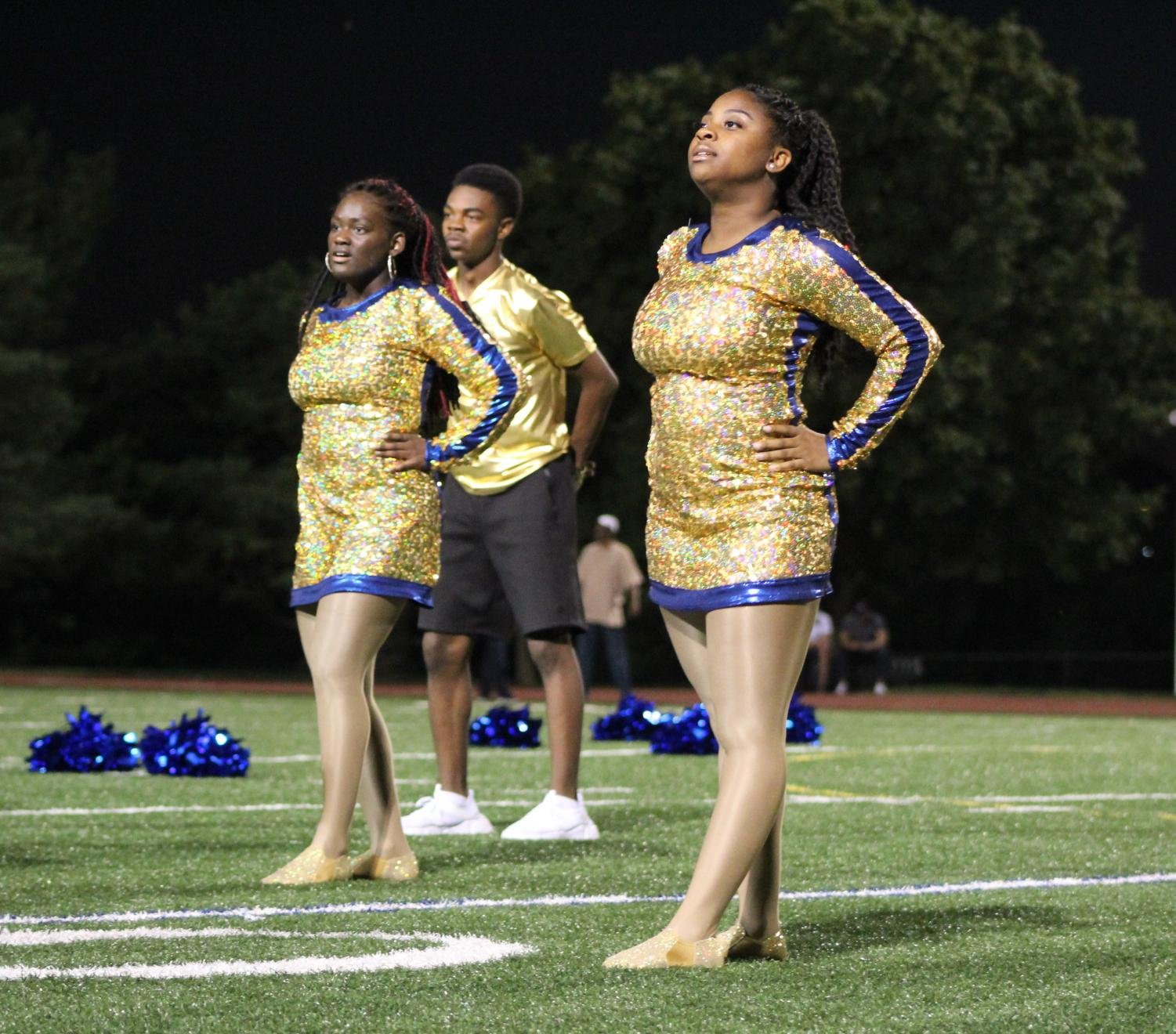Kayleah Turner, 12, Daevian Danner, 10, and Alisha Russell, 11, stand in place ready to start their dance. Photo by Caitlin Pieters