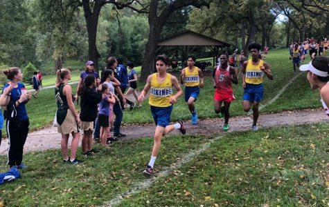 "Damian Frausto runs in front of teammates and an Omaha South opponent. ""Hard work will take me where ever I want to go,"" Frausto said. Photo courtesy of Damian Frausto"