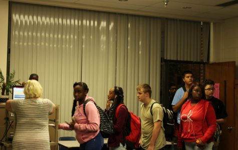 Students wait in line to get a tardy pass to their A1 class. Photo by Nadia Spurlock