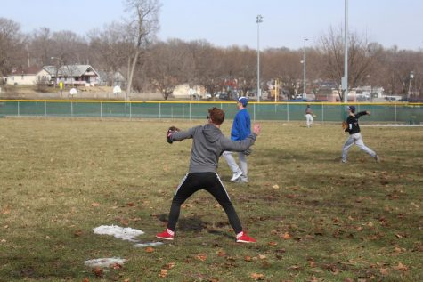 Blake Heuertz, 12, plays catch with one of his teammates to warm up on Mar. 18, 2019. Photo by Jessica Stacy