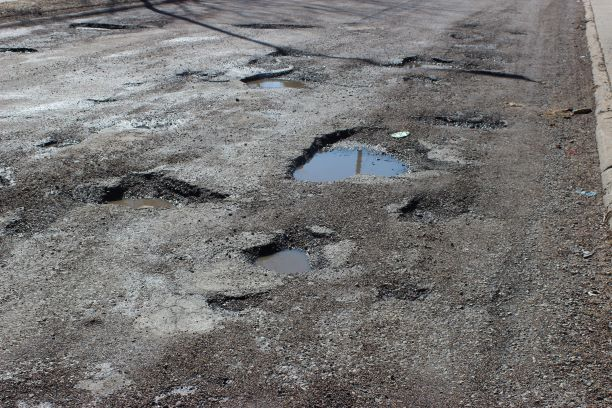 A cluster of potholes formed on 36th street just south of Ames. This section of the 36th is used by many student, parents, teachers and bus drivers to get in and out of the Omaha North High parking lot. Photo by Zach Hansen