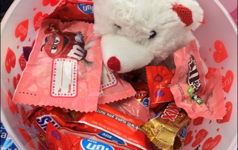 This is an example of a $12 basket order for Valentine's Day. This version contained candy, a brownie, a teddy bear, and more.  Photo courtesy of BSLC
