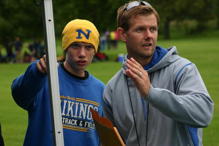 Coach Gudgel explains the Fremont course to varsity runner Zack Lundberg