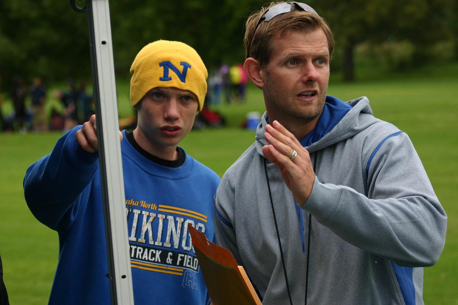 Coach Gudgel explains the Fremont course to varsity runner Zack Lundberg