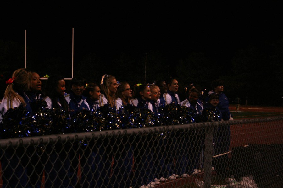 The cheerleaders get ready to do a chant with the crowd at the north homecoming game at Nile Kinnick stadium on October 11. North won the game 56-0.