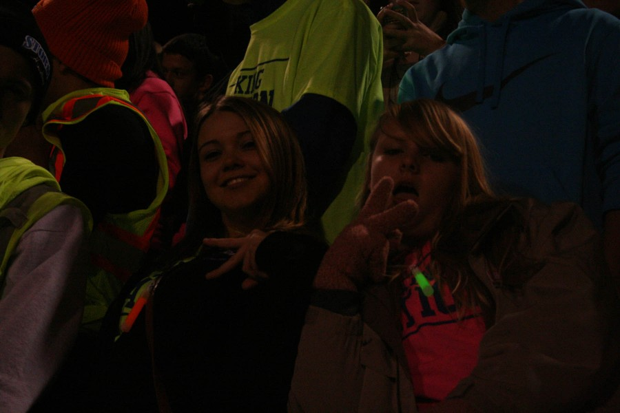 Jaicie Byers and Lillie Worden keep warm at the Homecoming game on October 11 at Nile Kinnick Stadium. North defeated South with the score of 56-0.