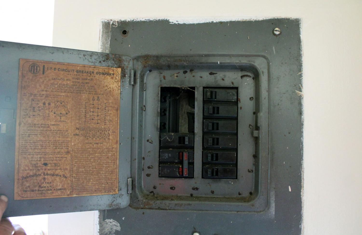 This is one of the many fuze boxes in the Yale Park Apartments that shows exposed wires which is a violation of city code. Photo by Dominick Bartels