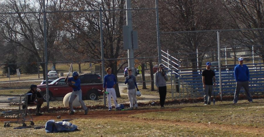 On Mar. 22 the Omaha North and Omaha Benson baseball team work together at practice. While the outfielders worked on bunting, the infielders worked on fielding the bunts and trying to get the runners out.  Photo by  Jessica Stacy